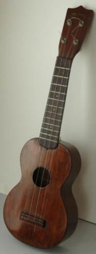 Martin O model wooden ukulele. Picture 1